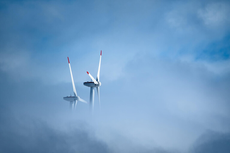 Wind turbines in the clouds.