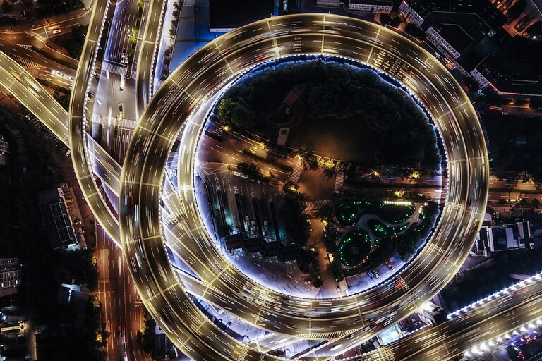A timelapse photos of a freeway loop at night.