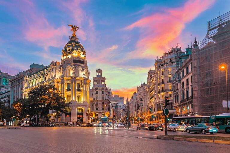 The Madrid Metropolis Building at sunset.