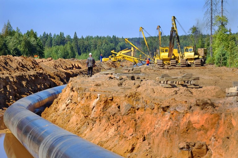 A gas pipeline being installed in the ground.