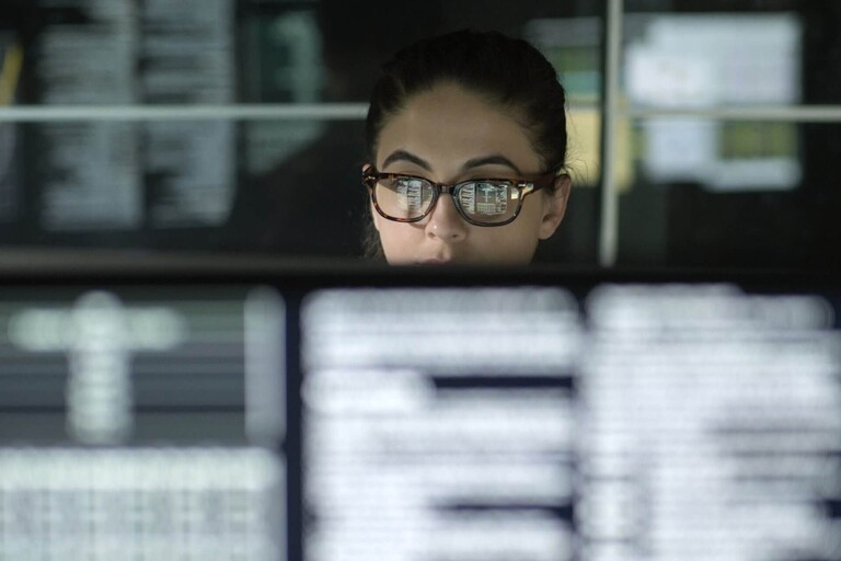 A woman reviewing data.